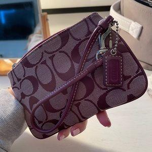 Purple coach wristlet wallet
